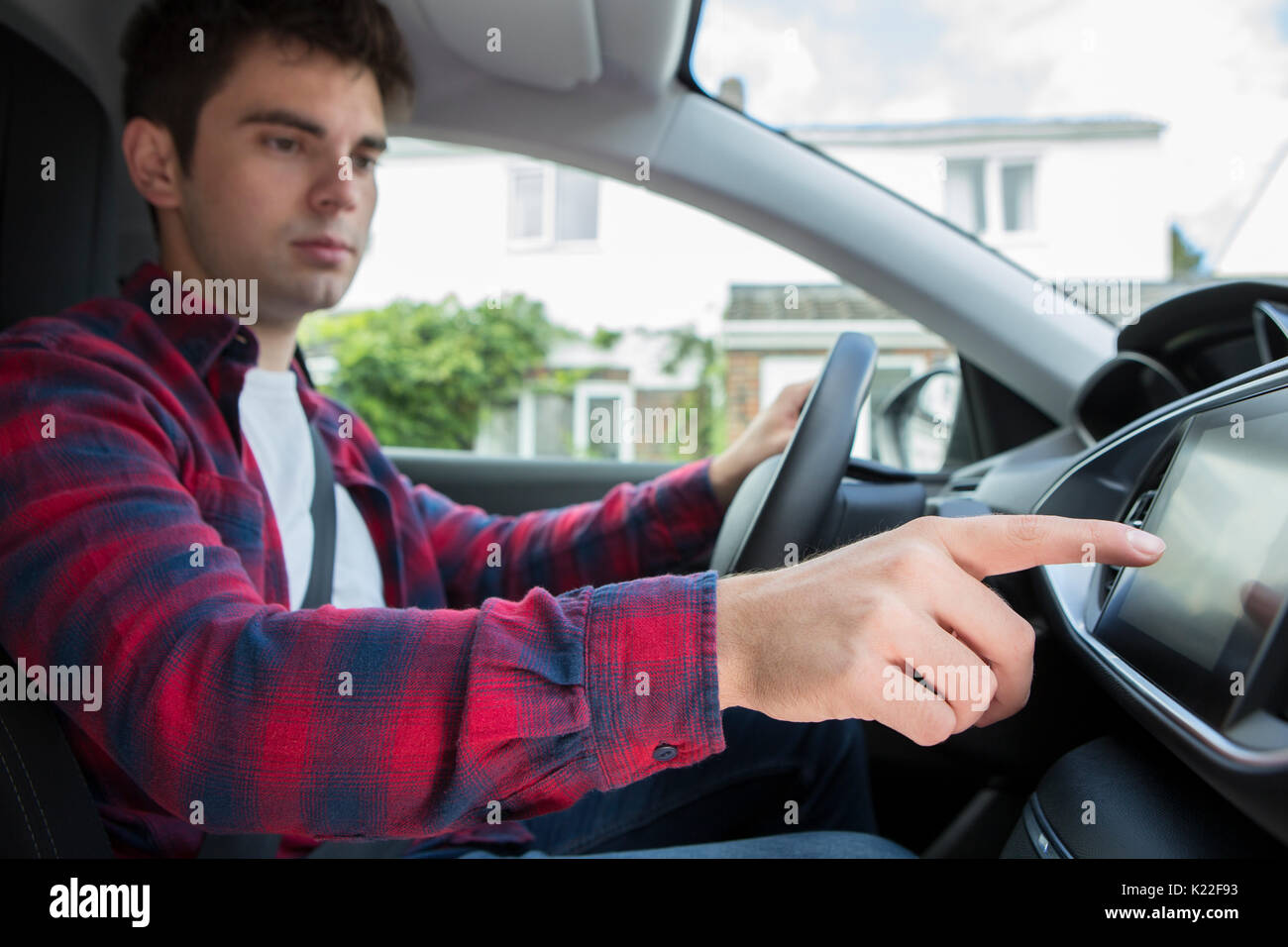 Male Driver Using Touchscreen In Car - Stock Image
