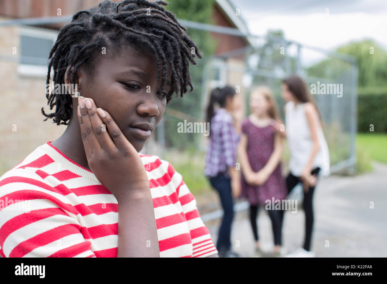 Sad Teenage Girl Feeling Left Out By Friends Stock Photo