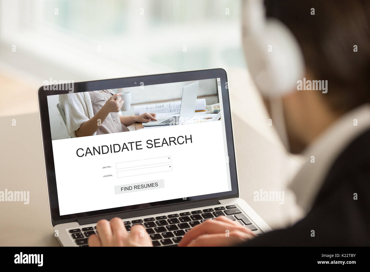 employer using laptop searching candidates find resumes online