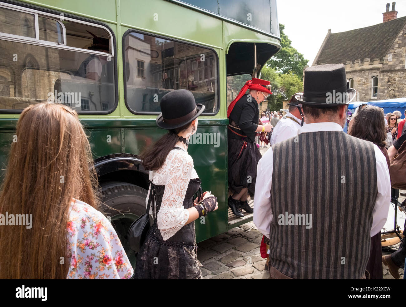 Old style bus dropping of people at the 2017 Lincoln Steampunk Festival, City of Lincoln, Lincolnshire UK - Stock Image
