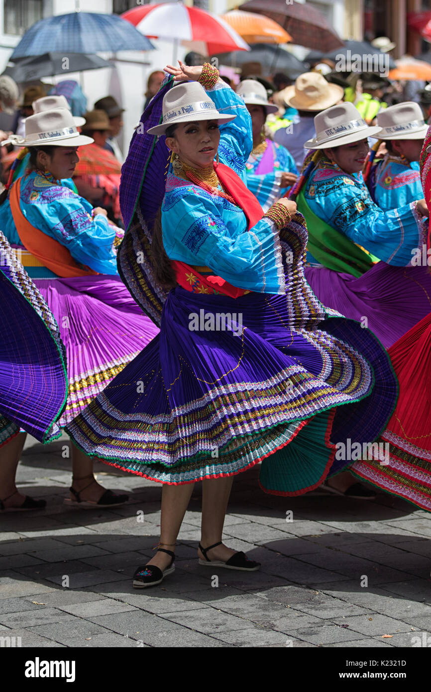 June 17, 2017 Pujili, Ecuador: young female dancer in traditional wear performing on the street at Corpus Christi celebrations - Stock Image