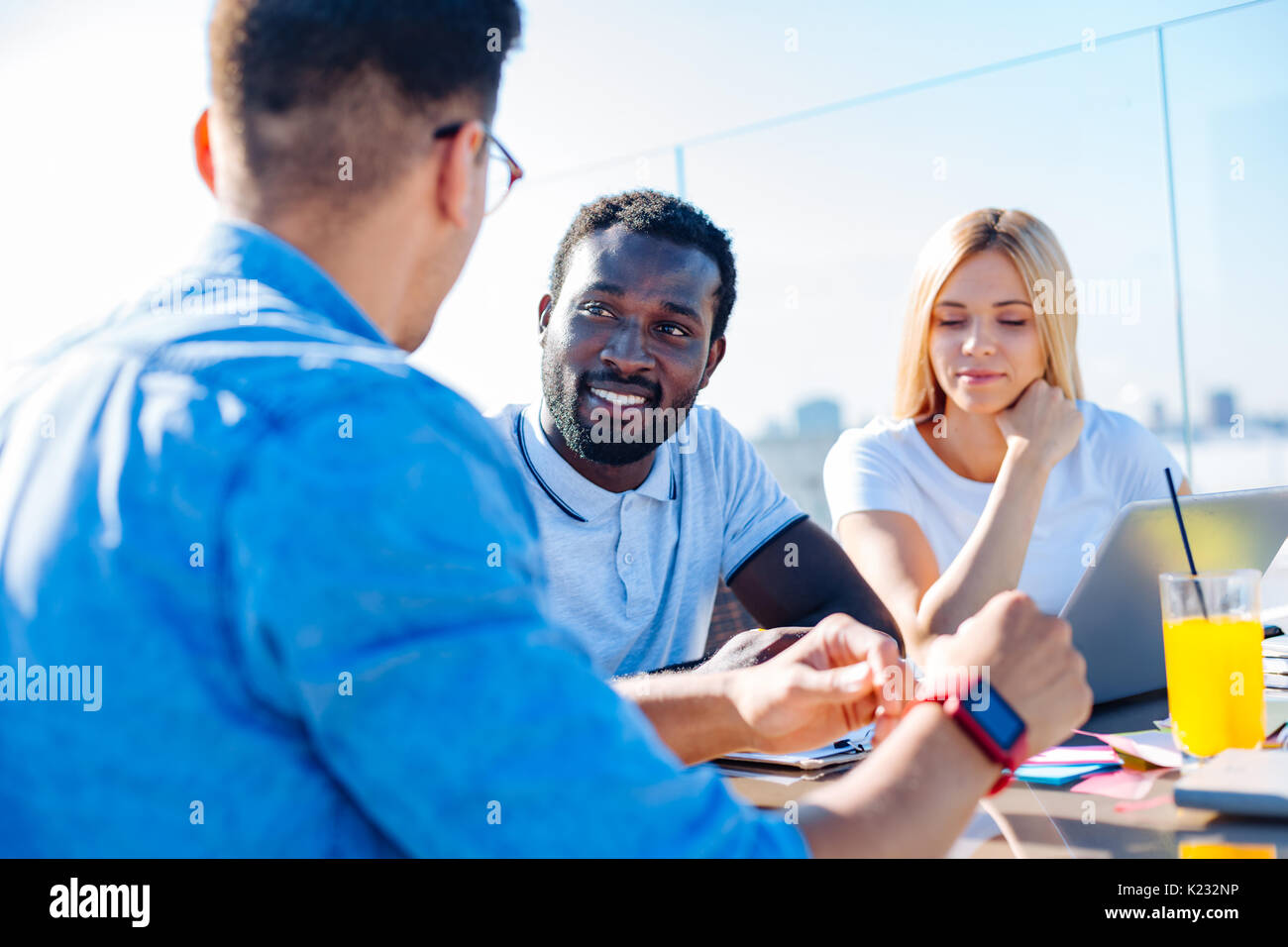 University people studying together in cafe - Stock Image