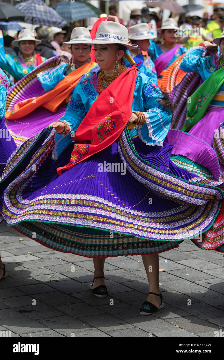 June 17, 2017 Pujili, Ecuador: female dancer in bright color traditional wear performing on the street at Corpus Stock Photo