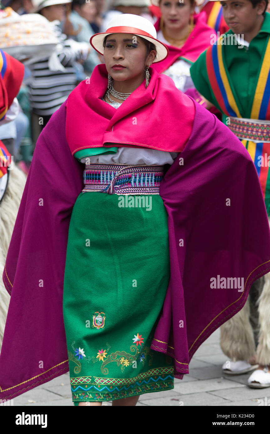 June 17, 2017 Pujili, Ecuador: female dancer in bright color traditional wear performing on the street at Corpus Christi celebrations - Stock Image