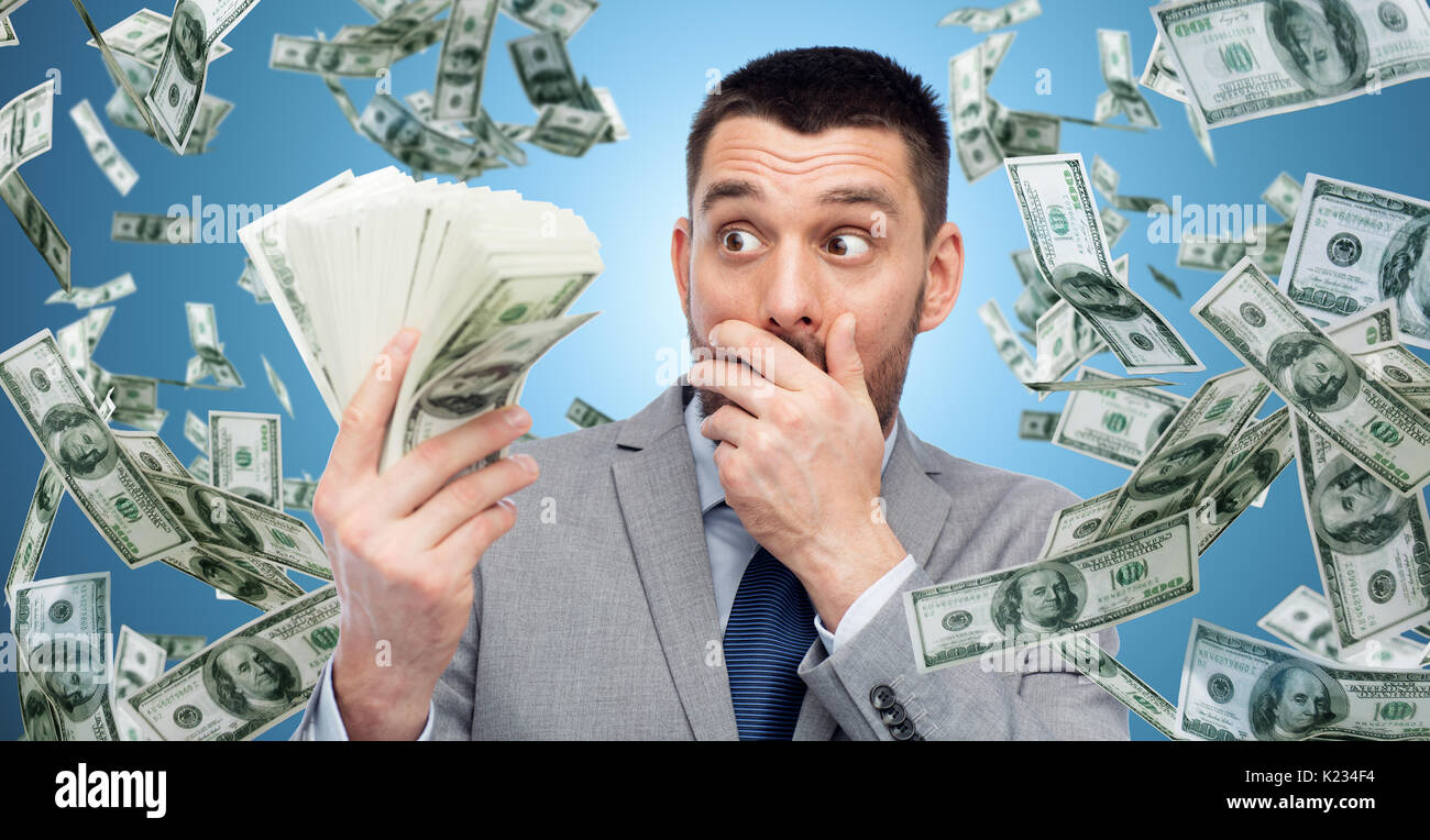 smiling businessman with american dollar money - Stock Image
