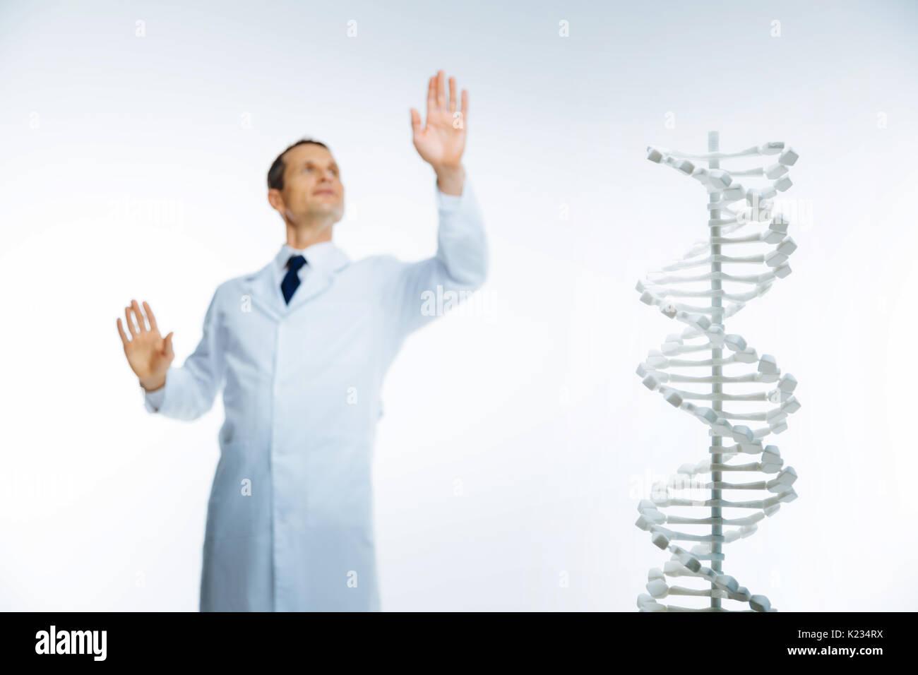 Male scientist studying genetics alone - Stock Image