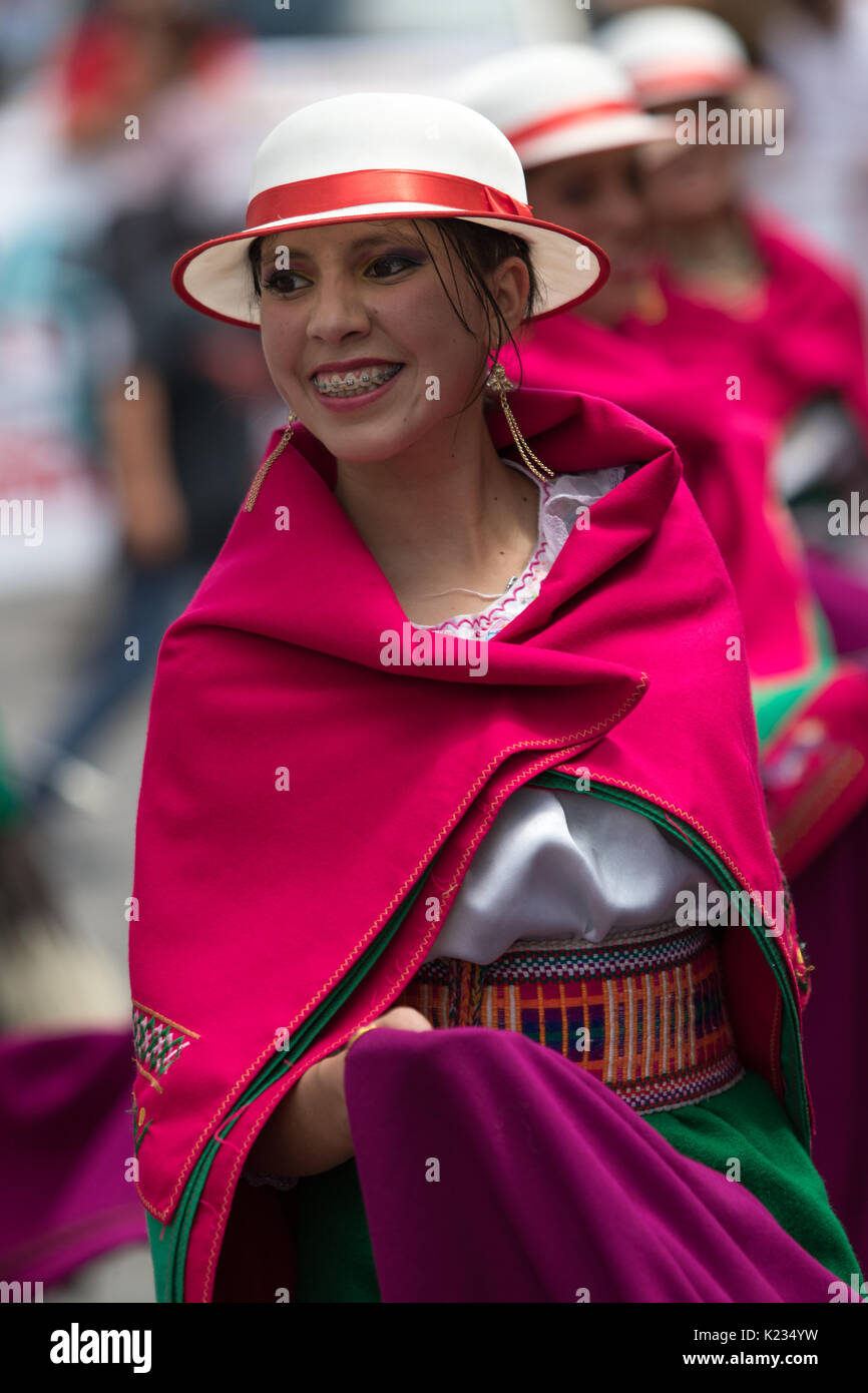 June 17, 2017 Pujili, Ecuador: indigenous female in colorful dress wearing a white hat at the Corpus Christi parade - Stock Image