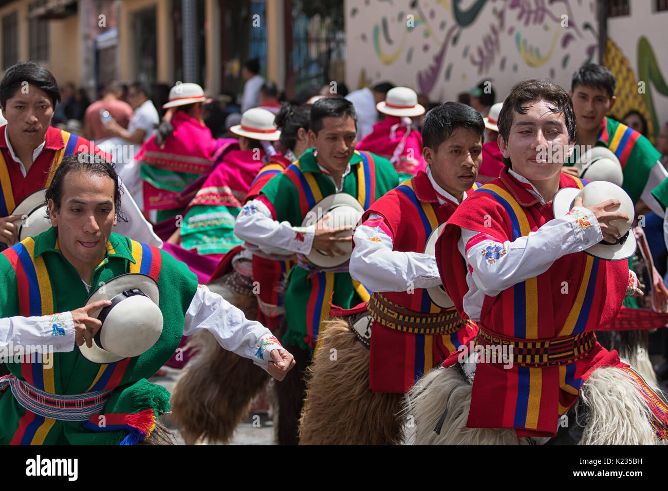June 17, 2017 Pujili, Ecuador: male dancers holding their hats in the air at Corpus Christi festival - Stock Image