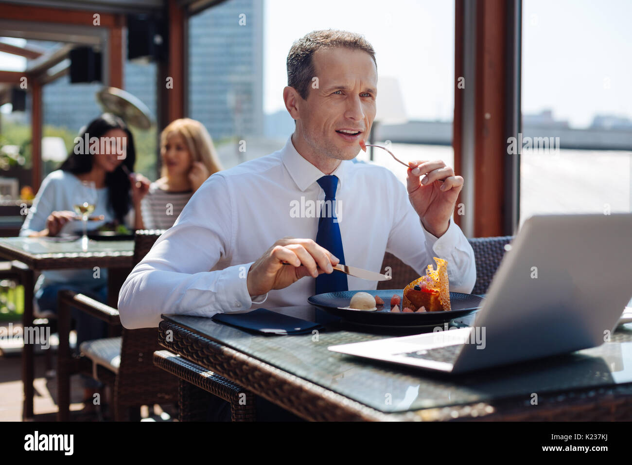 Handsome nice businessman holding a fork - Stock Image