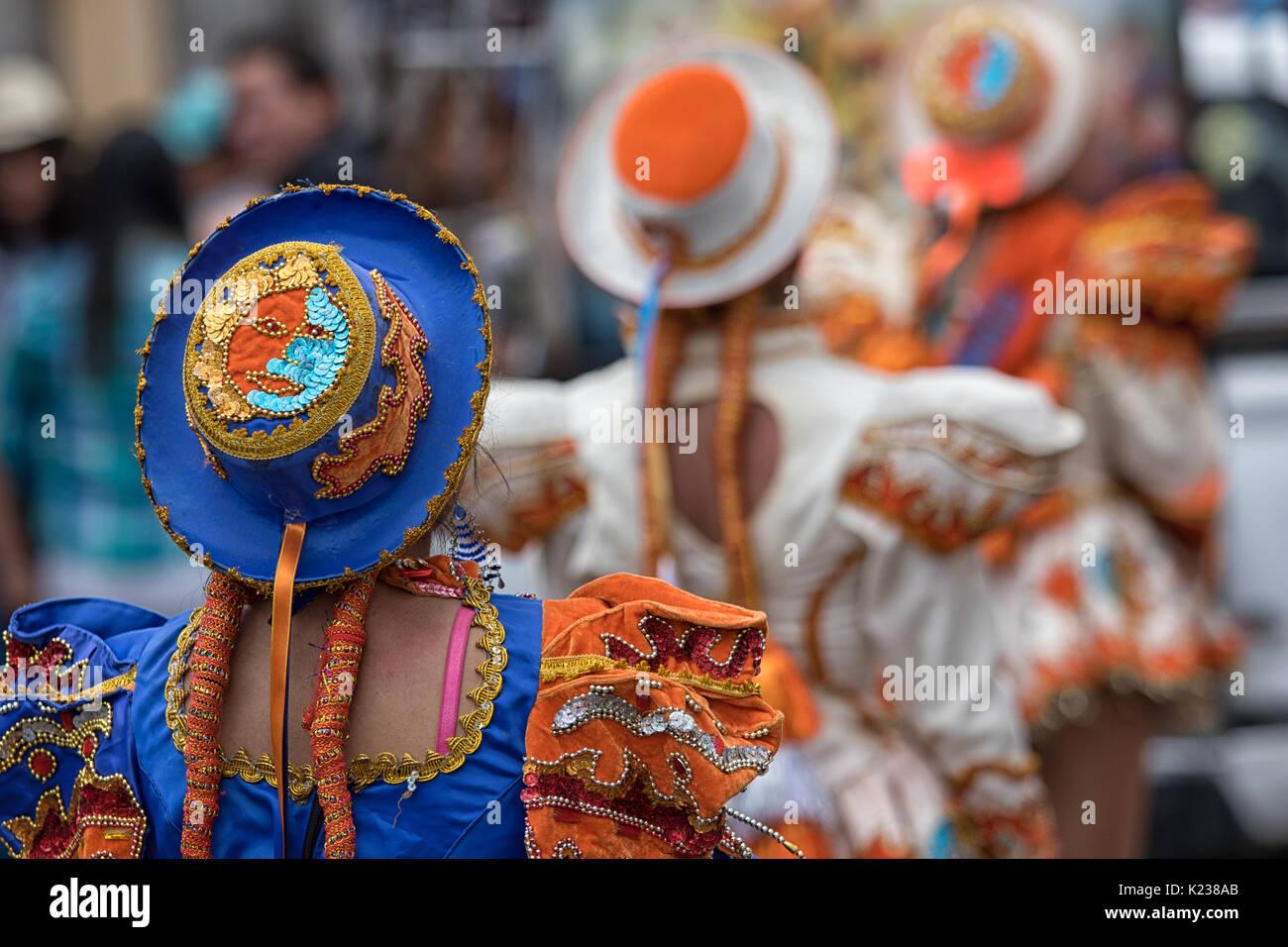 June 17, 2017 Pujili, Ecuador: closeup details of colorful indigenous female costume and hat at Corpus Christi annual parade - Stock Image