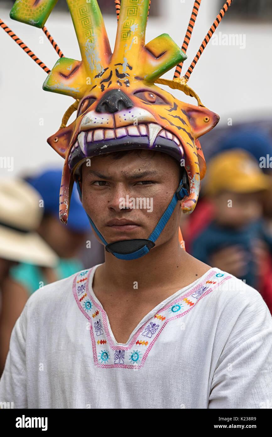 June 17, 2017 Pujili, Ecuador: indigenous quichua man wearing a mask during the Corpus Christi annual parade - Stock Image