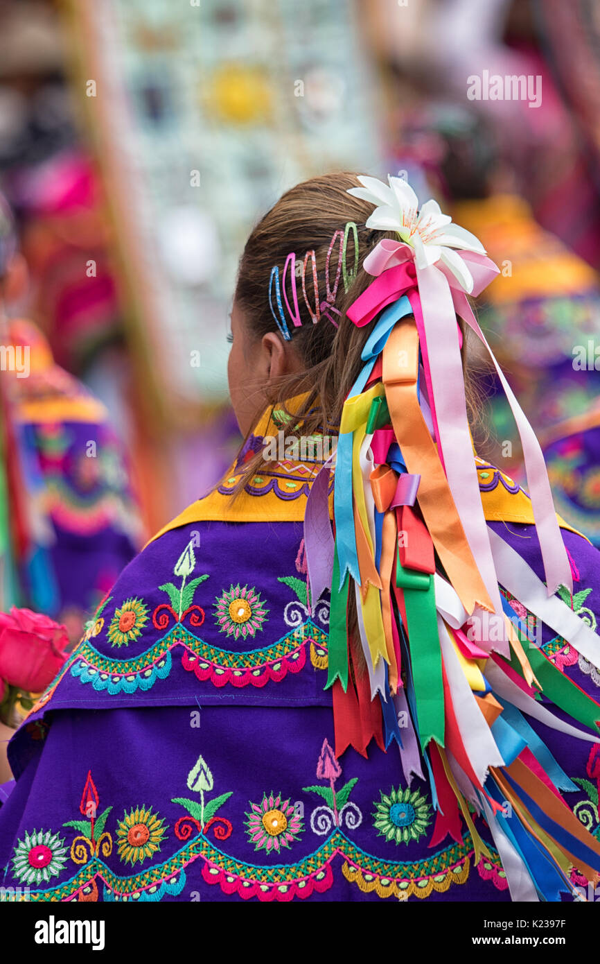 June 17, 2017 Pujili, Ecuador: colourful hair decoration and clothing of a woman at the Corpus Christi annual celebration in the Andean town - Stock Image