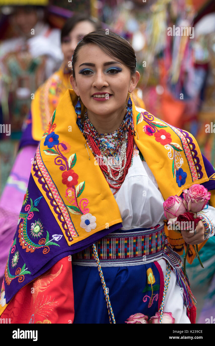 June 17, 2017 Pujili, Ecuador: the variety and color range of costumes worn during Corpus Christi parade is impressive - Stock Image