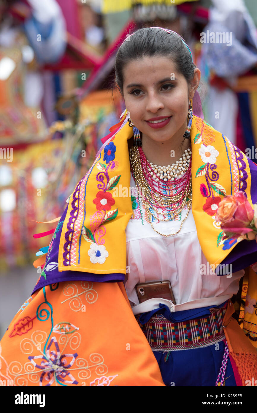 June 17, 2017 Pujili, Ecuador: indigenous quechua dancer wearing colorful tradition clothing with a cell phone tucked Stock Photo