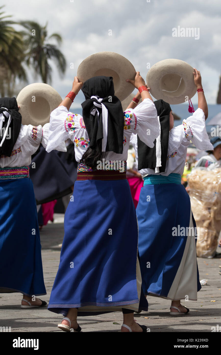 June 17, 2017 Pujili, Ecuador: female indigenous dancers in traditional clothes performing in the street during Corpus Christi festival - Stock Image