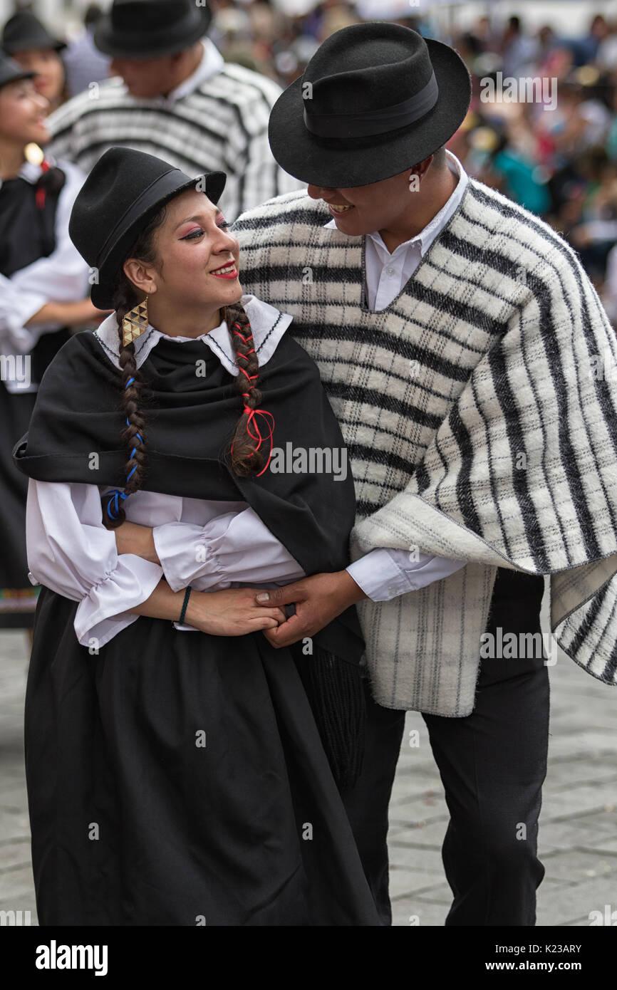 June 17, 2017 Pujili, Ecuador: indigenous man and woman dancing in traditional costumes at Corpus Christi parade - Stock Image