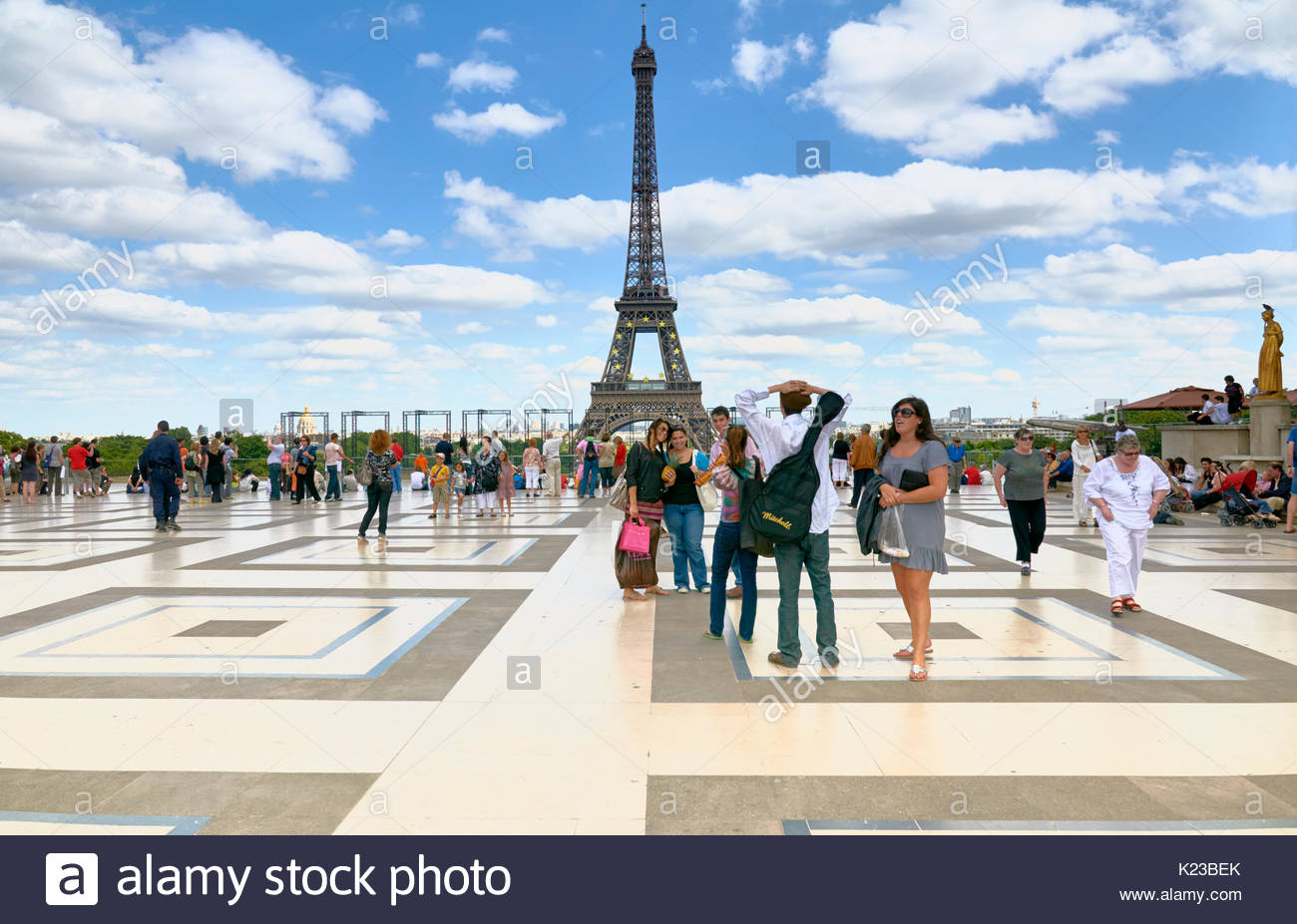People standing, talking and relaxing on the Trocadero in front of the Eiffel tower in Paris France Europe - Stock Image