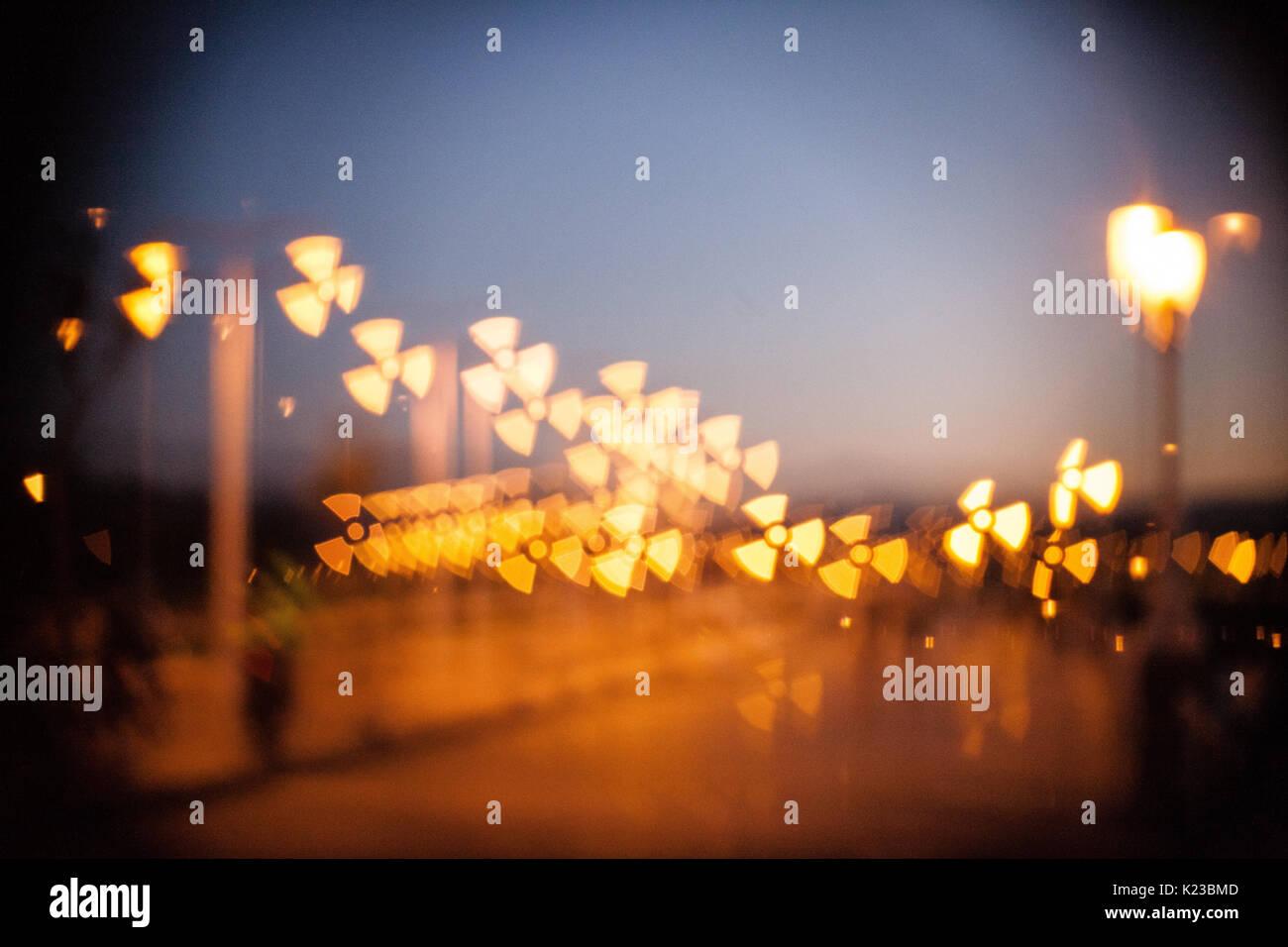 Street lights with radiation symbol Stock Photo