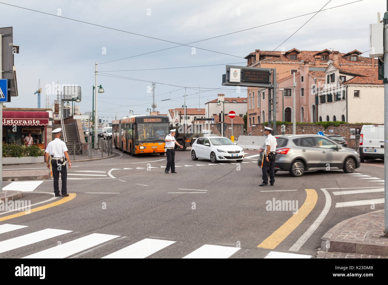 Venice, Veneto, Italy. 28th Aug, 2017. Anti-terror concrete barriers and police presence in Piazzale Roma ahead of the start of the Venice Film Festival. Officers directing vehicles. This is the first day after completion of the installation of the barriers to check the viabilty of traffic flow and pedestrians. An armoured car was in place on Ponte della Liberta blocking one lane. The barriers are designed to block any vehicular attack. Credit: Mary Clarke/Alamy Live News - Stock Image