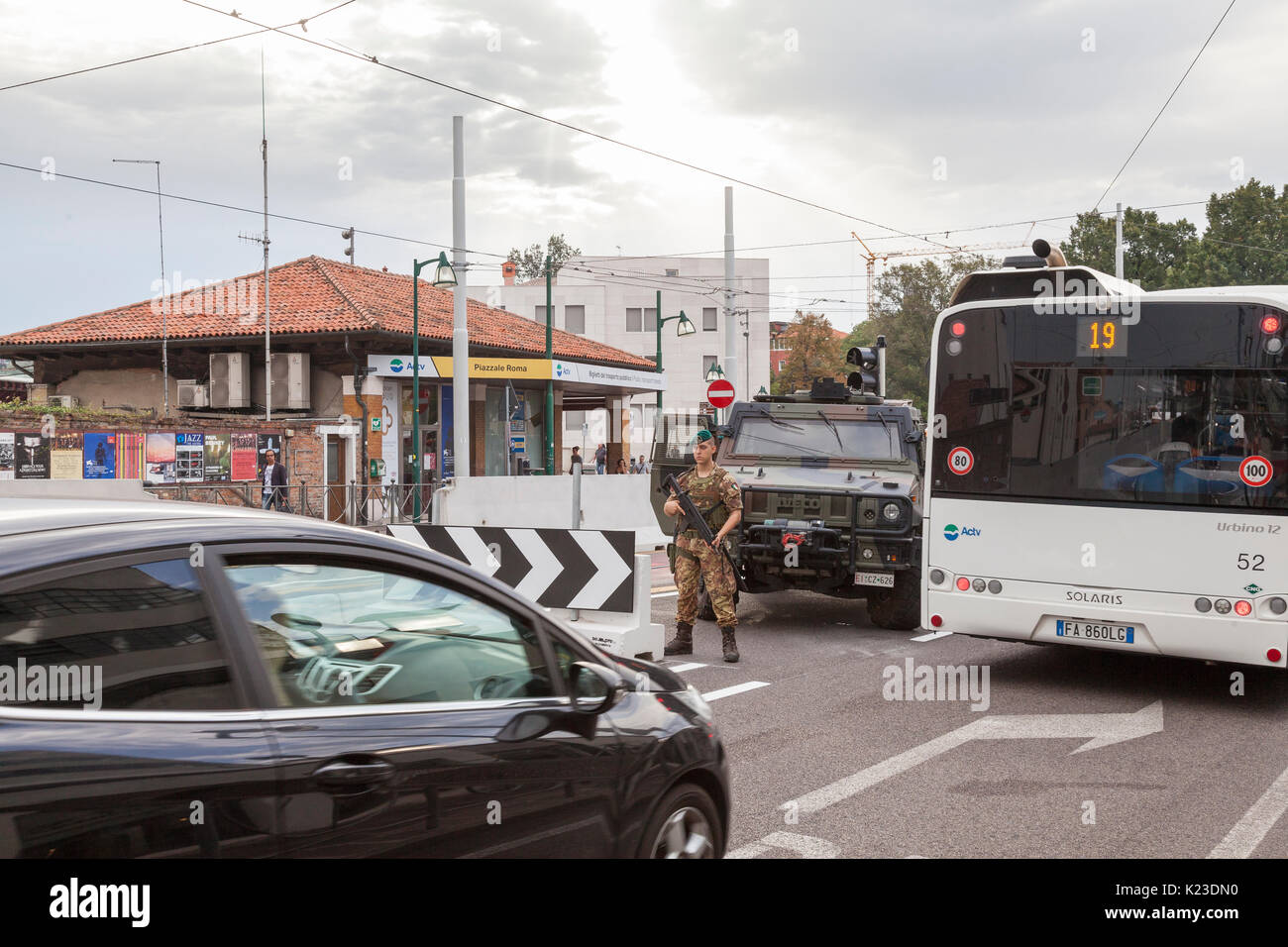 Venice, Veneto, Italy. 28th Aug, 2017. Anti-terror concrete barriers and police presence in Piazzale Roma ahead of the start of the Venice Film Festival. This is the first day after completion of the installation of the barriers to check the viabilty of traffic flow and pedestrians. An armoured car and soldier were in place on Ponte della Liberta blocking one lane watching traffic. The barriers are designed to block any vehicular attack. Credit: Mary Clarke/Alamy Live News - Stock Image