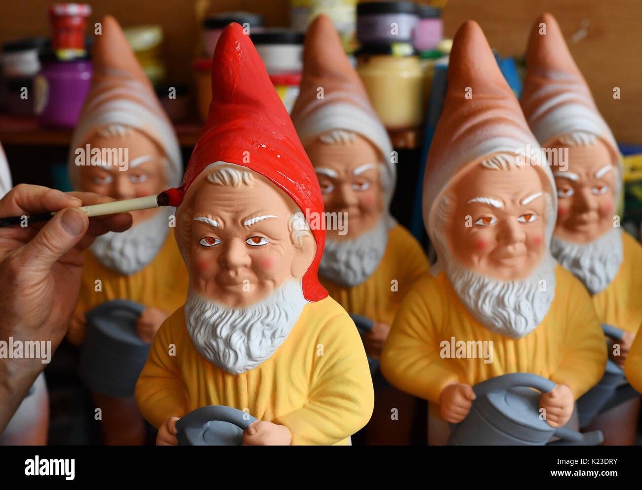 Graefenroda, Germany. 25th Aug, 2017. Garden gnomes, photographed at the garden gnome manufactory in Graefenroda, Germany, 25 August 2017. More than 500 different figures between four and 60 centimeters are manufactured here. Since 1874, the Griebel family has been producing the burnt clay figures and is now the only company in Germany. Most clients outside of Germany are from France, Austria, Italy, the Netherlands and Switzerland. Photo: Jens Kalaene/dpa-Zentralbild/dpa/Alamy Live News - Stock Image
