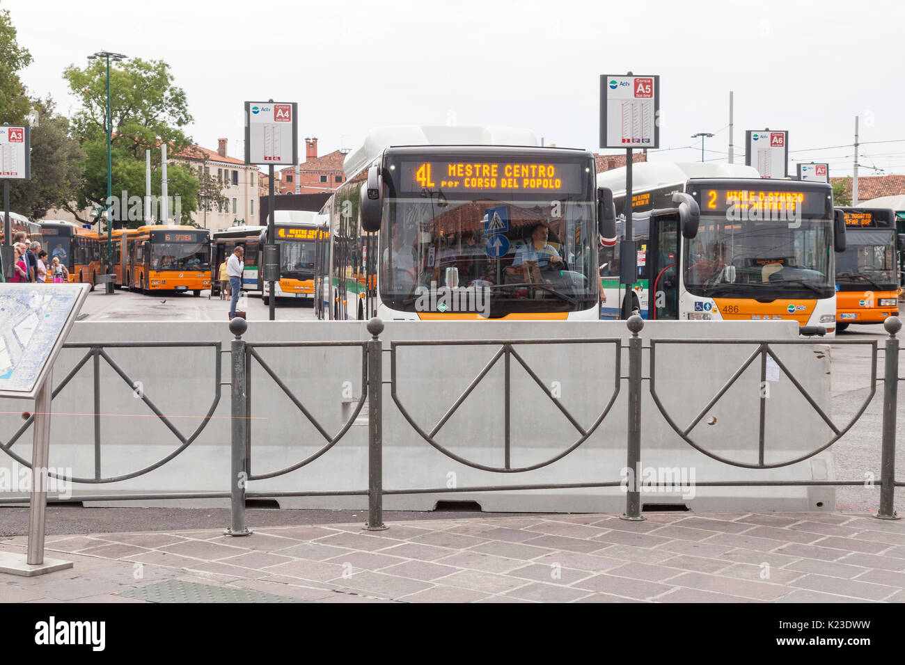 Venice, Veneto, Italy, 28th August 2017. Anti-terror concrete barriers and police presence in Piazzale Roma ahead of the start of the Venice Film Festival. This is the first day after completion of the installation of the barriers to check the viabilty of traffic  flow and pedestrians. Bus drivers sit waiting to depart in their buses behind the barrier. An armoured car was in place on Ponte della Liberta. The barriers are designed to block any vehicular attack. Credit Mary Clarke/Alamy Live news - Stock Image