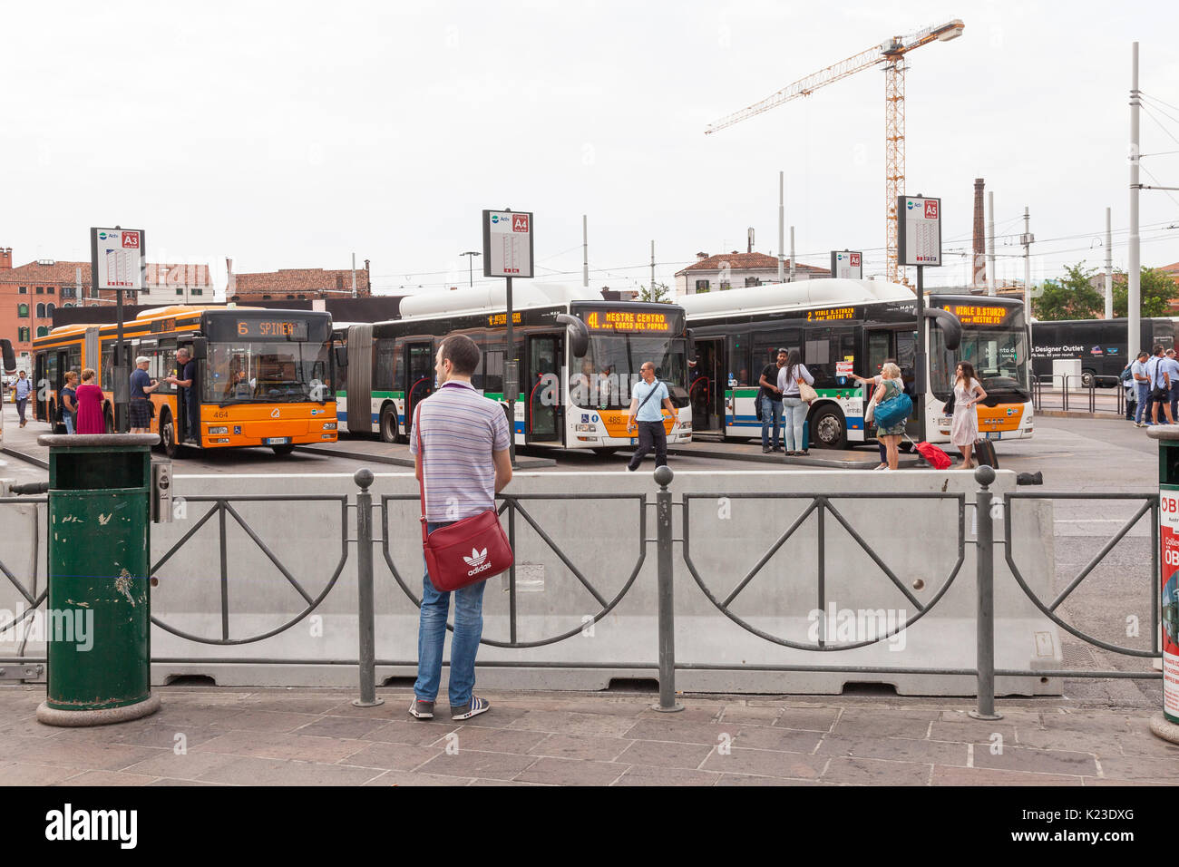 Venice, Veneto, Italy, 28th August 2017. Anti-terror concrete barriers and police presence in Piazzale Roma ahead of the start of the Venice Film Festival. This is the first day after completion of the installation of the barriers to check the viabilty of traffic  flow and pedestrians. Buses behind the barrier watched by a Venetian man. An armoured car was in place on Ponte della Liberta. The barriers are designed to block any vehicular attack. Credit Mary Clarke/Alamy Live news - Stock Image