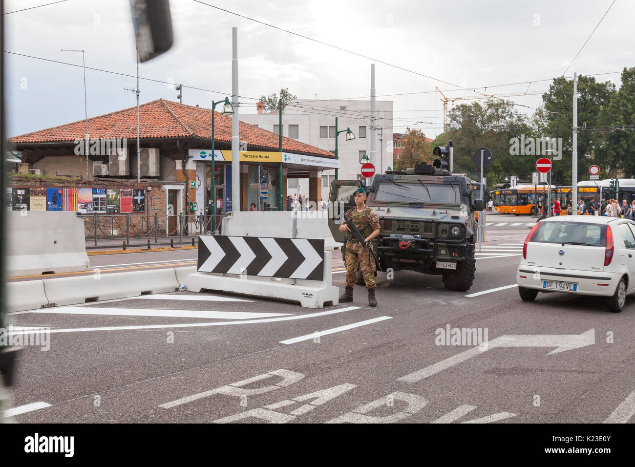 Venice, Veneto, Italy, 28th August 2017. Anti-terror concrete barriers and police presence in Piazzale Roma ahead of the start of the Venice Film Festival. This is the first day after completion of the installation of the barriers to check the viabilty of traffic  flow and pedestrians. An armoured car and soldier were in place on Ponte della Liberta blocking one lane. The barriers are designed to block any vehicular attack. Credit Mary Clarke/Alamy Live news - Stock Image