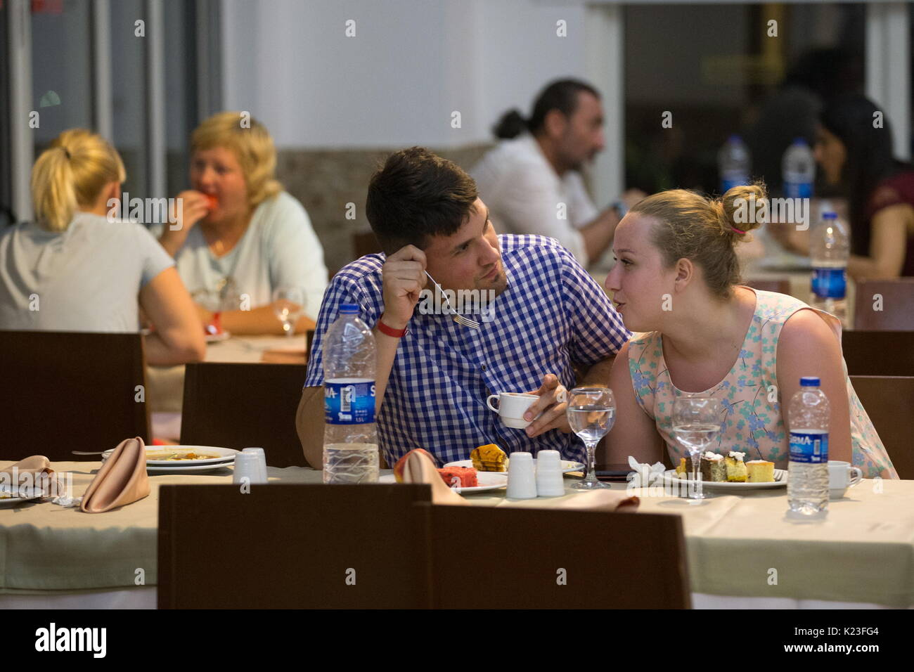 Kemer, Turkey. 22nd Aug, 2017. Tourists in a restaurant at the Meder Resort Hotel. Credit: Sergei Bobylev/TASS/Alamy Live News - Stock Image