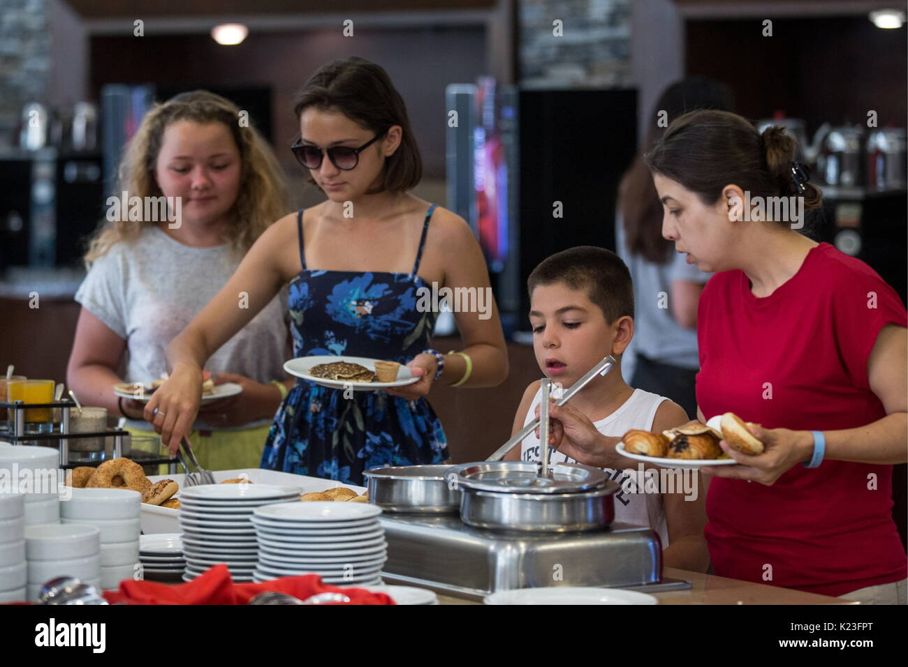 KEMER, TURKEY - AUGUST 26, 2017: Tourists in a buffet at the Meder Resort Hotel. Sergei Bobylev/TASS - Stock Image