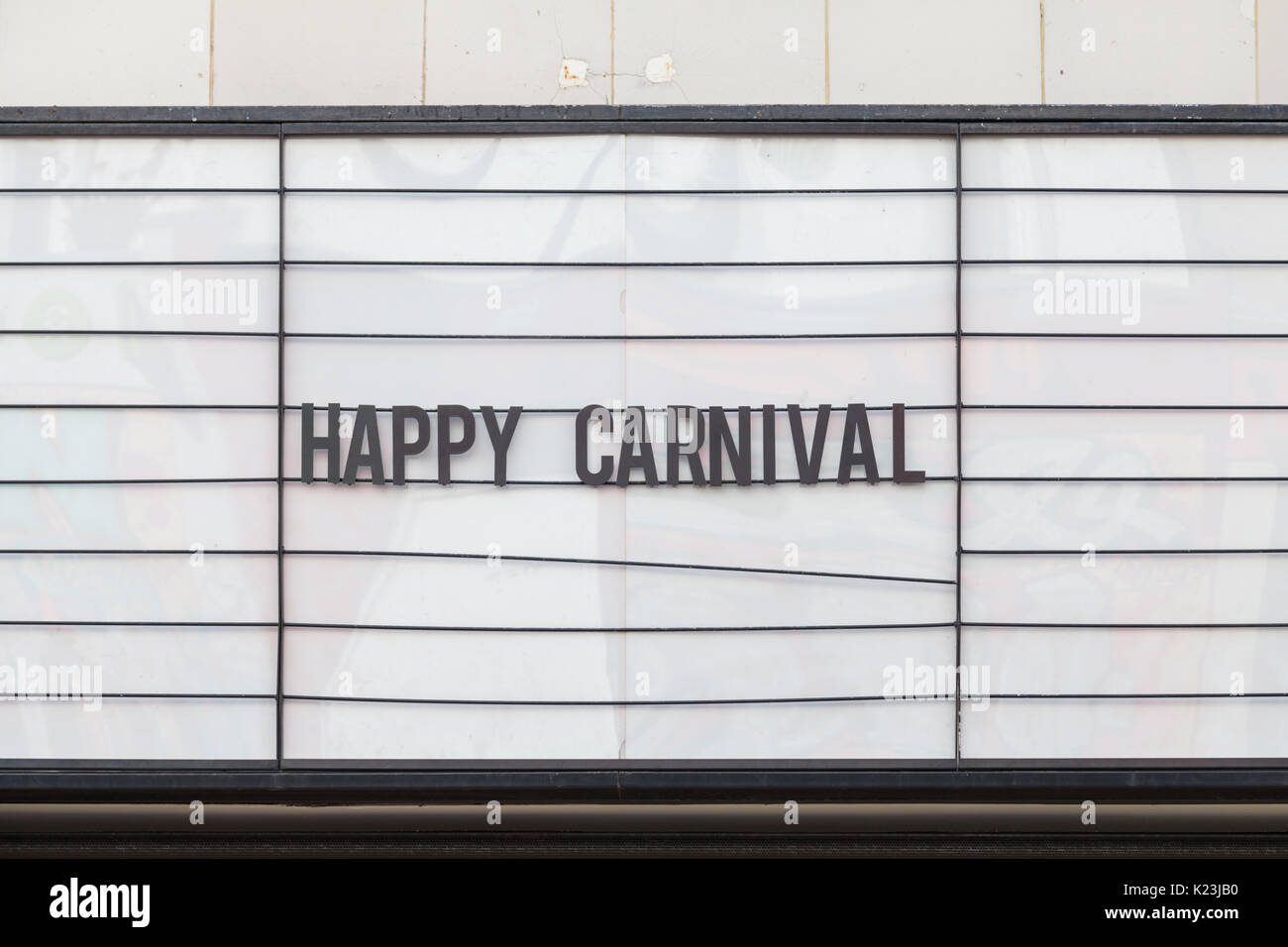Notting Hill, London, UK, 28th August 2017. Happy Carnival sigh outside the 'Electric' Cinema.Notting Hill Carnival is Europe's biggest street festival celebrating  London's Caribbean community and multicultural heritage since 1964 in Notting Hill, Ladbroke Grove and Westbourne Park. Credit: Imageplotter News and Sports/Alamy Live News - Stock Image