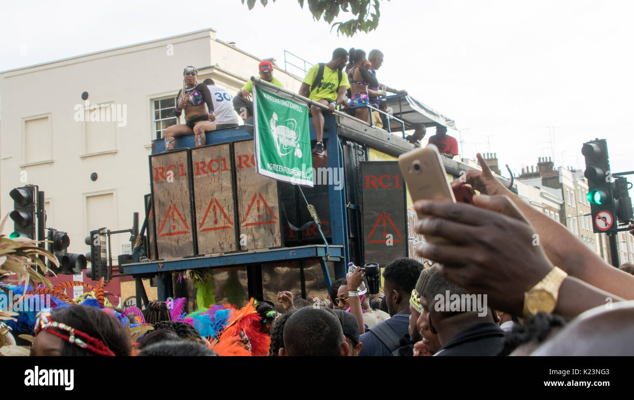 London, England, UK. 28th Aug, 2017. The main events of Notting Hill Carnival 2017 get underway, today, on Bank Holiday Monday. This year is the 51st anniversary of the Carnival, with over a million revellers expected to hit the streets of West London, amongst floats, masqueraders, steel bands, and sound systems. Celebrations have paused for a minute's silence for the victims of June's Grenfell Tower fire tragedy, which took place nearby. Credit: Iain McGuinness/Alamy Live News - Stock Image