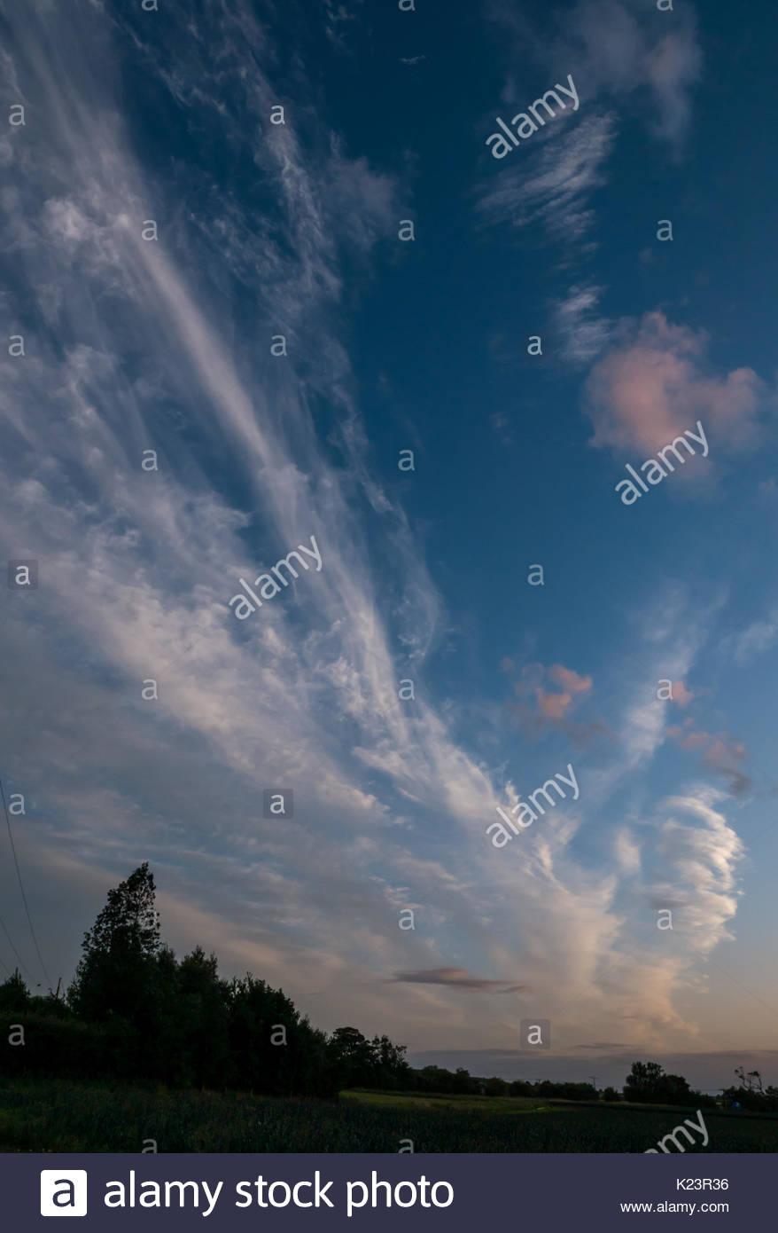 East Lothian, Scotland, United Kingdom, 29th August 2017. UK Weather. Glorious dusk blue sky with high wispy cloud Stock Photo