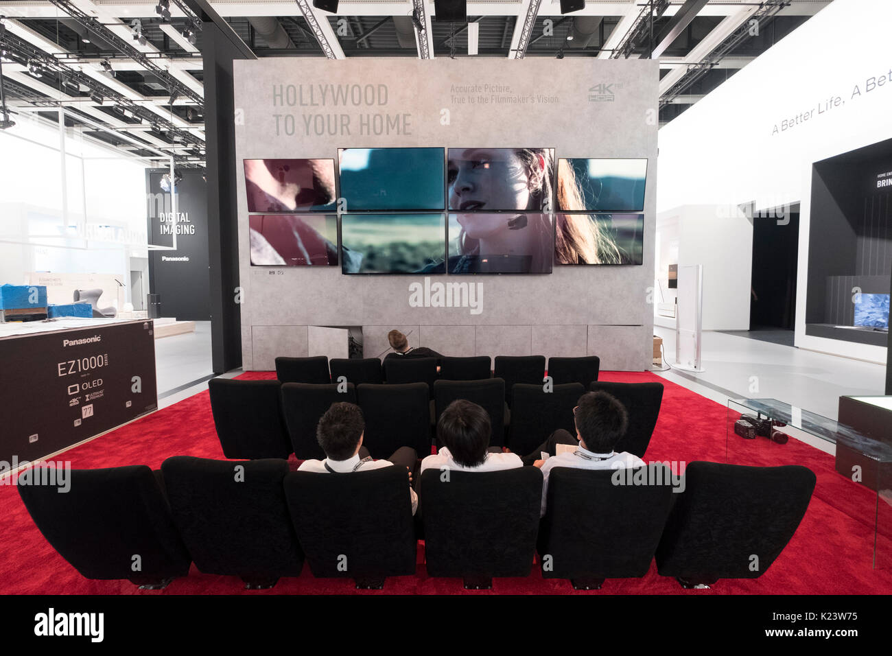 Berlin, Germany. 30th Aug, 2017. Exhibitors preparing stands prior to opening to the public on 1 Sept 2017. Home cinema exhibit demonstrating 4K televisions on Panasonic stand. IFA is one of the world's largest consumer electronics trade show. Credit: Iain Masterton/Alamy Live News - Stock Image