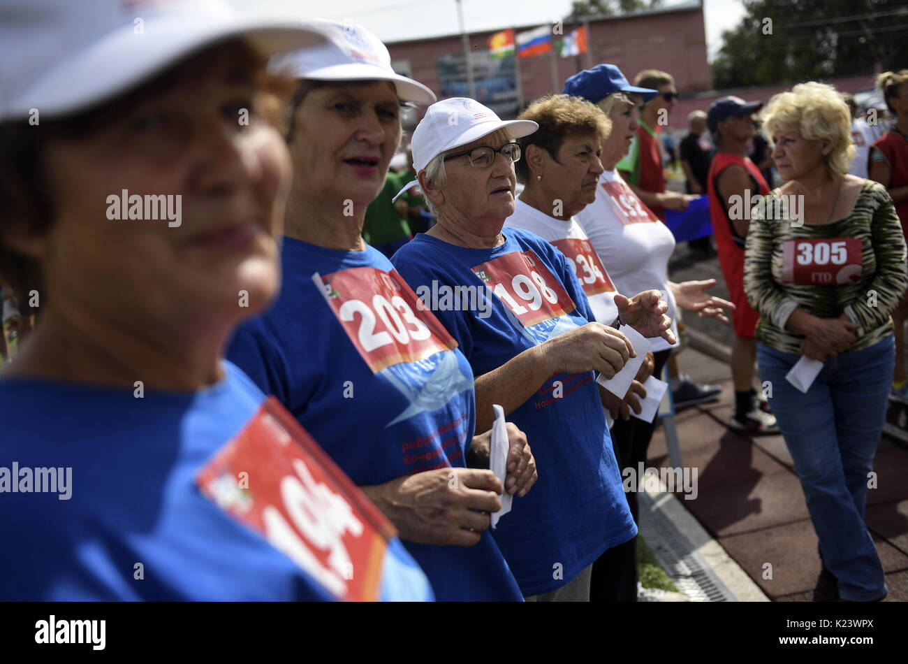 Novosibirsk Region, Russia. 30th Aug, 2017. Elderly people take Soviet-era physical fitness tests in the village of Kochenevo. A fitness programme 'Ready for Labour and Defence' [known by Russian acronym GTO] introduced by Joseph Stalin in the 1930s to get the nation into shape has been recently revived in Russia. Credit: Kirill Kukhmar/TASS/Alamy Live News - Stock Image