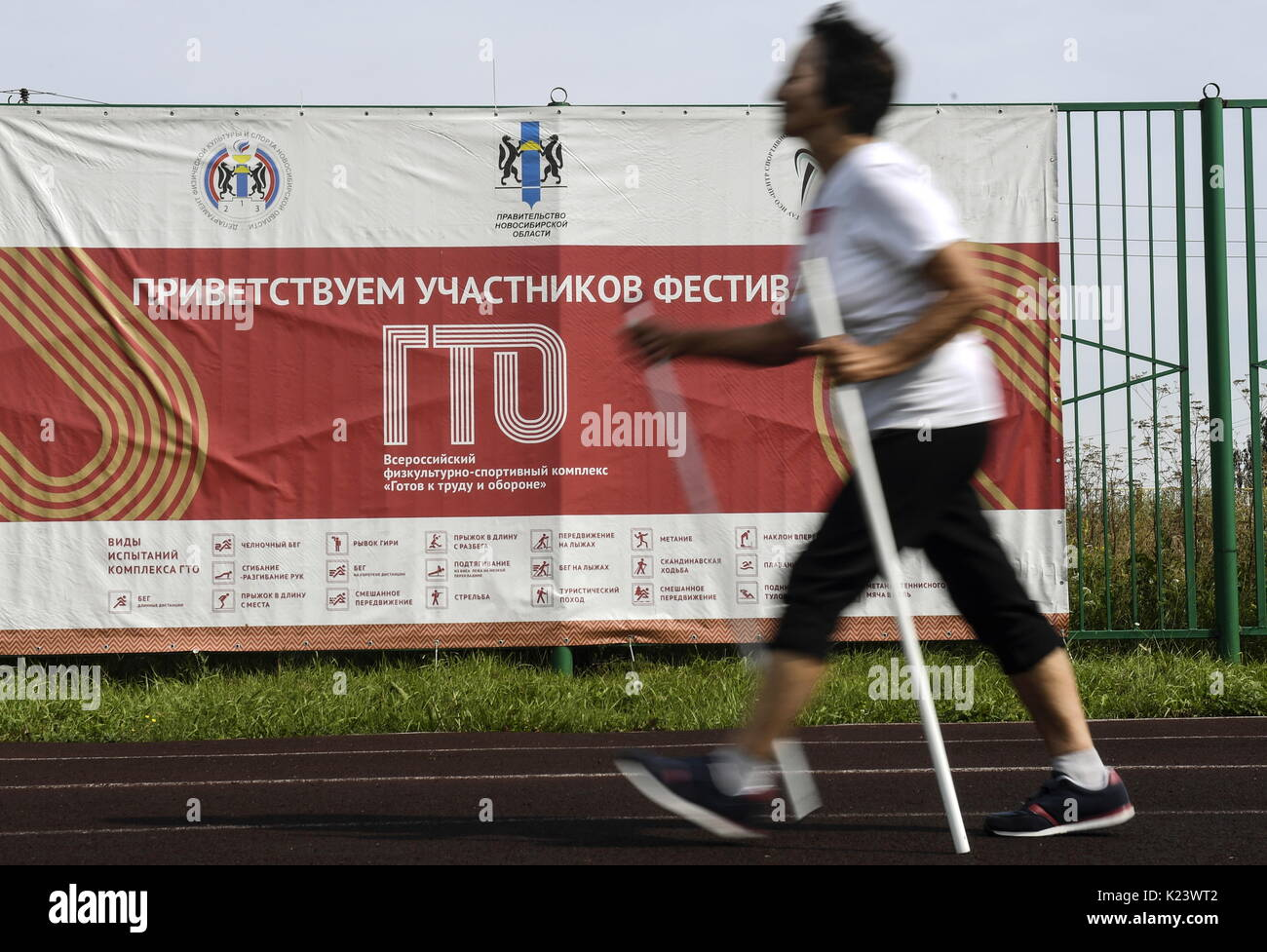 Novosibirsk Region, Russia. 30th Aug, 2017. An elderly woman Nordic walking as she takes Soviet-era physical fitness tests in the village of Kochenevo. A fitness programme 'Ready for Labour and Defence' [known by Russian acronym GTO] introduced by Joseph Stalin in the 1930s to get the nation into shape has been recently revived in Russia. Credit: Kirill Kukhmar/TASS/Alamy Live News - Stock Image