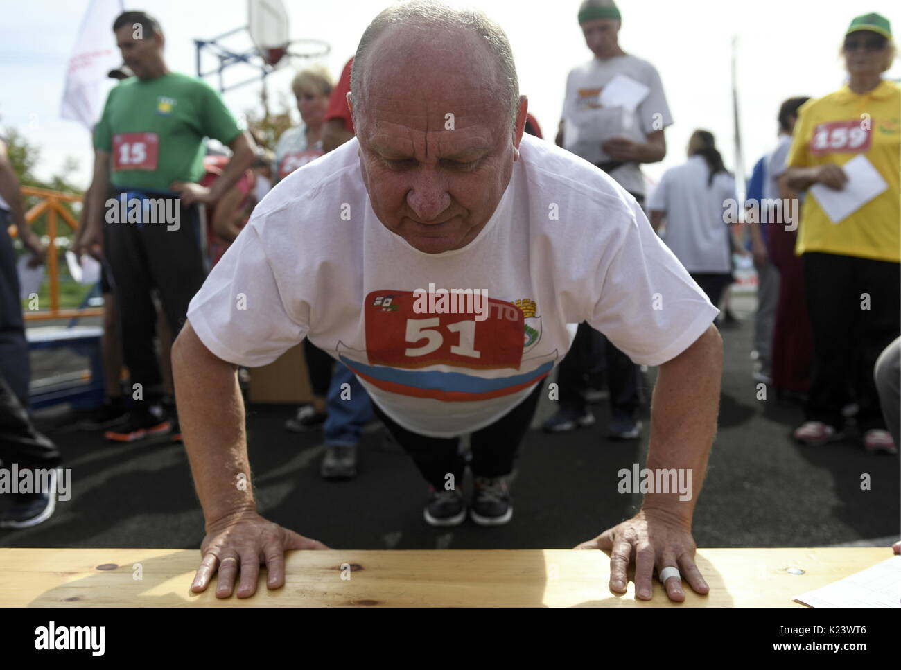 Novosibirsk Region, Russia. 30th Aug, 2017. An elderly man takes Soviet-era physical fitness tests in the village of Kochenevo. A fitness programme 'Ready for Labour and Defence' [known by Russian acronym GTO] introduced by Joseph Stalin in the 1930s to get the nation into shape has been recently revived in Russia. Credit: Kirill Kukhmar/TASS/Alamy Live News - Stock Image
