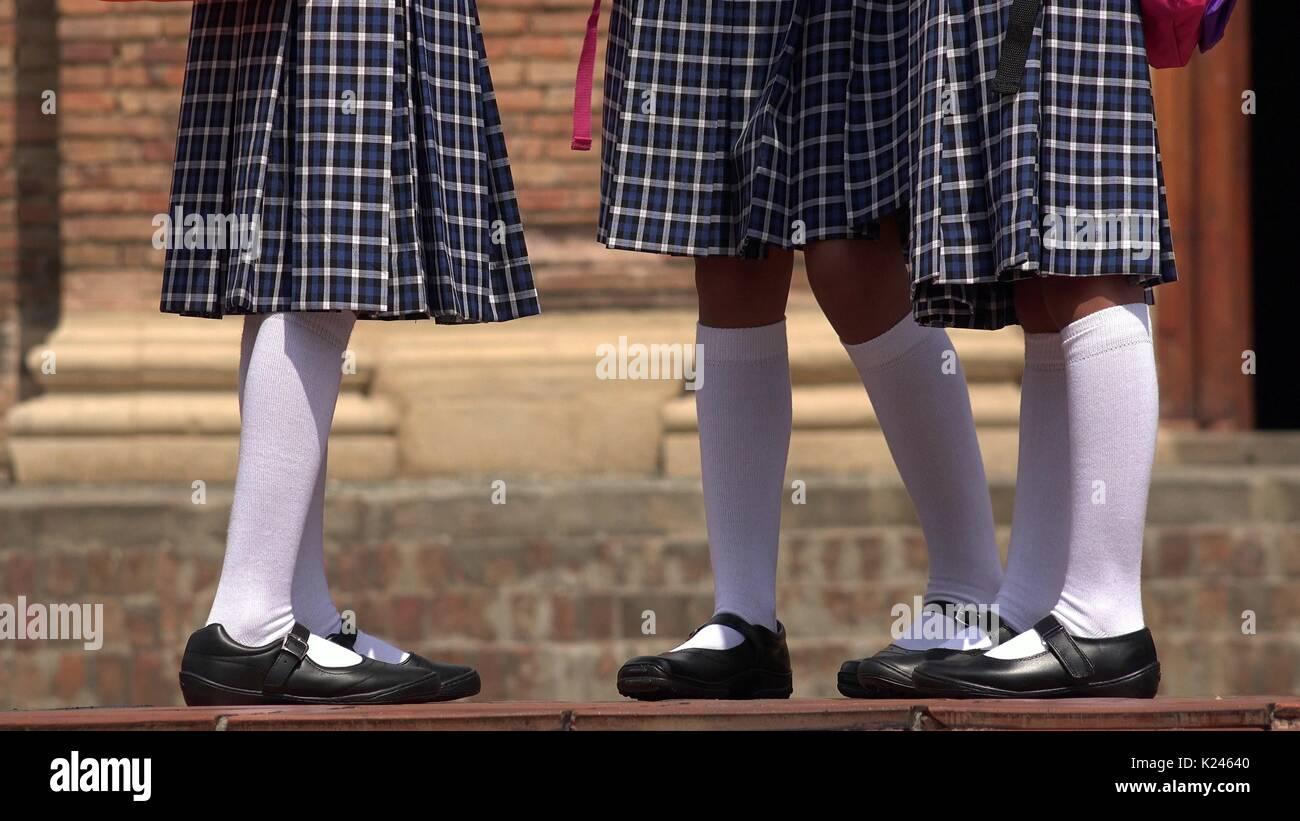 Catholic School Girls With Skirts And White Socks - Stock Image