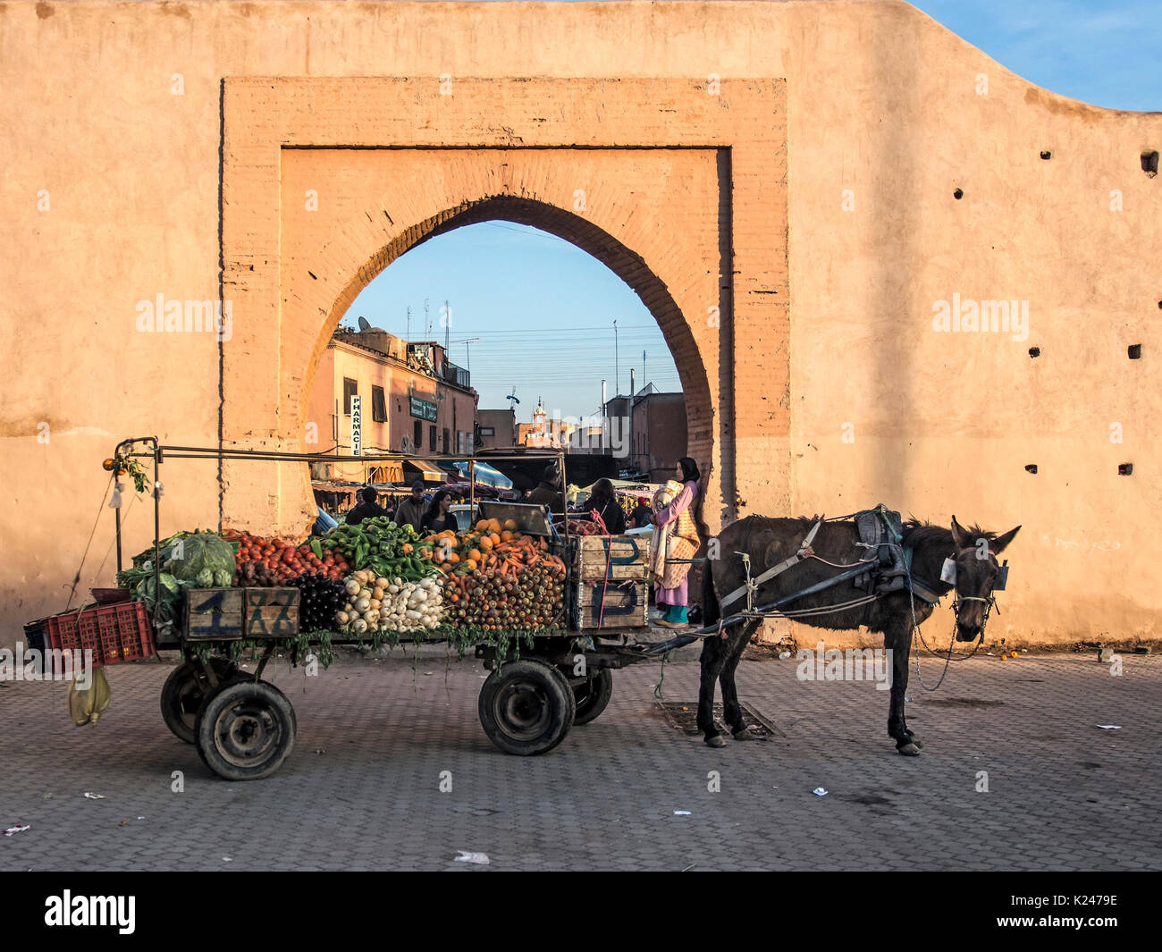 MARRAKESH, MOROCCO:  Donkey drawn cart with load of vegetables by a Gate in the City walls Stock Photo
