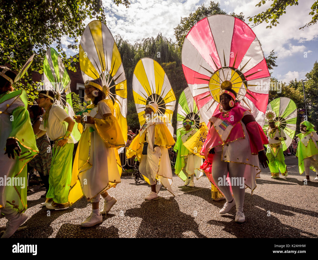 Leeds, UK. 28th August, 2017.  The 50th Leeds West Indian Carnival at Potternewton Park. The carnival was the first in the UK, in 1967, to incorporate all three essential elements of authentic West Indian carnival – costumes, music and a masquerade procession – it is Europe's longest running Caribbean carnival parade. The event incorporates a colourful procession through the streets, a live music stage and street food and is geared towards all ages and cultures. Photo Bailey-Cooper Photography/Alamy Live News - Stock Image