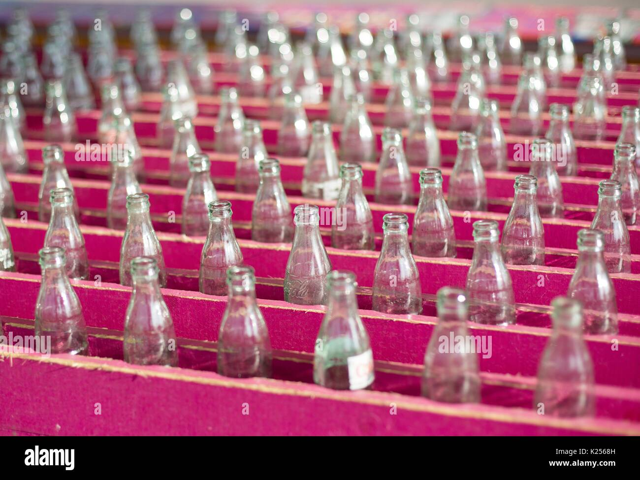 Rows of Coke bottles make up part of a ring toss game at the Minnesota State Fair. - Stock Image