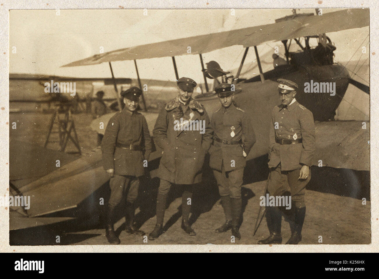 Four German pilots in front of biplane Stock Photo