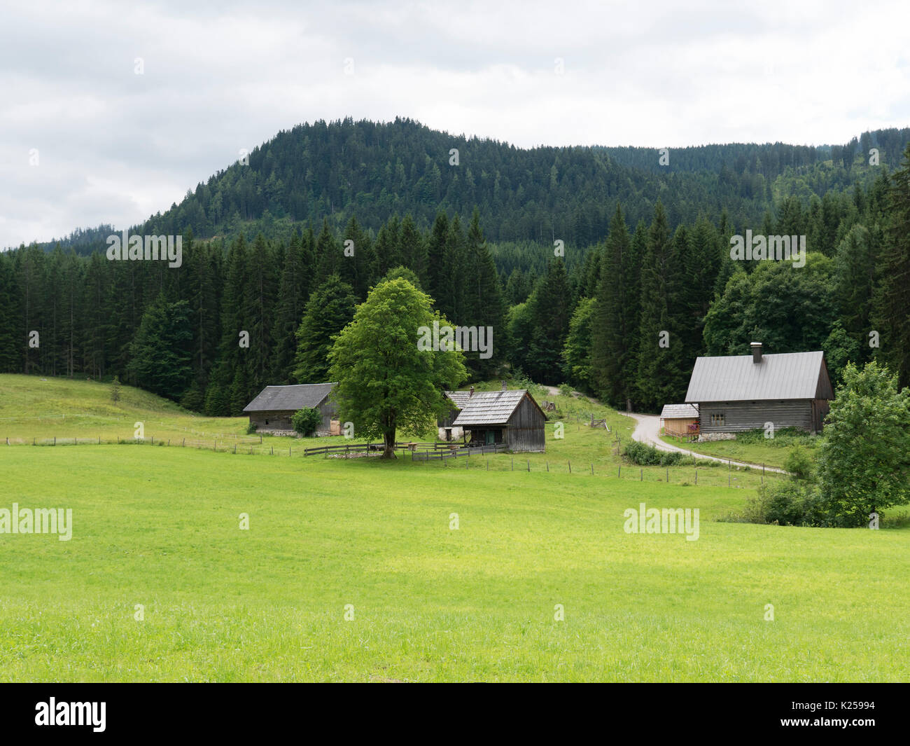 Alpine mountain medieval village. Wooden timbered cottages. Tourist open-air museum, travel destination for holidays. Mountain scenery near Salzburg. - Stock Image