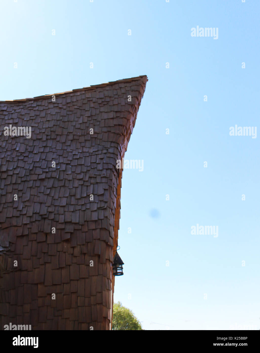 Wooden roof like in fairytale and he sky - Stock Image