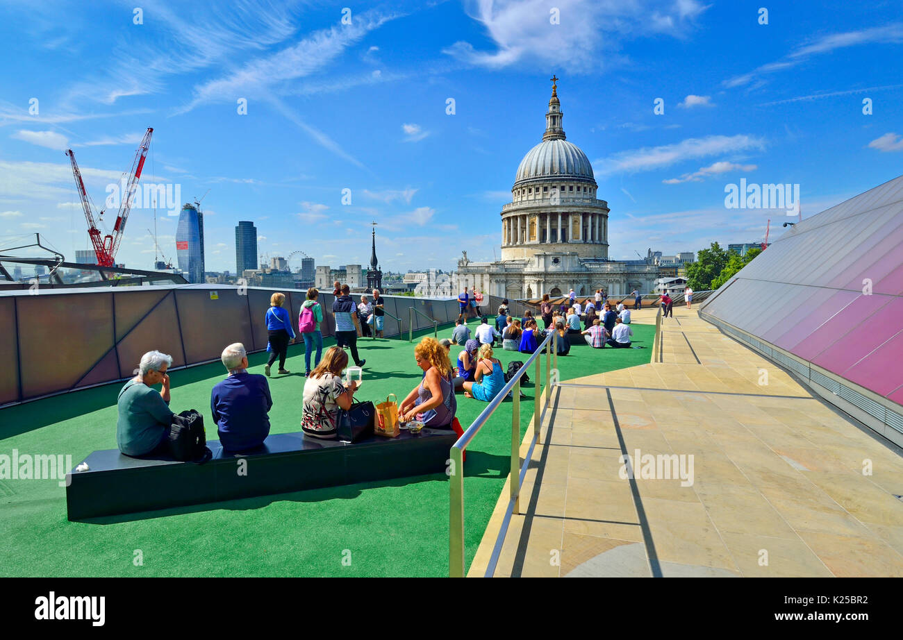 London, England, UK. St Paul's Cathedral seen from the public rooftop terrace of One New Change - people having lunch on a sunny day in August - Stock Image