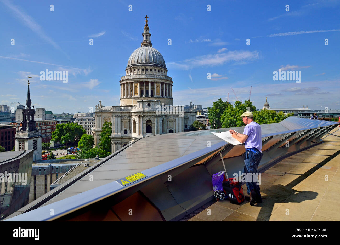 London, England, UK. St Paul's Cathedral seen from the public rooftop terrace of One New Change - artist drawing the cathedral - Stock Image