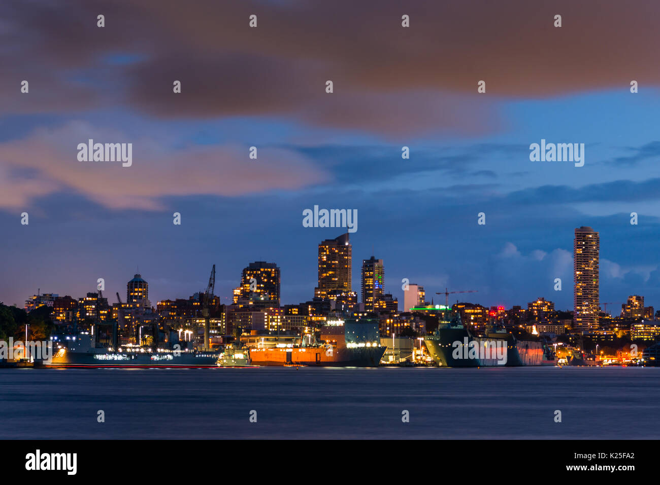 Garden Island Naval base and Potts Point skyline at dusk, seen from Cremorne point. Sydney Harbour, New South Wales, Australia. - Stock Image