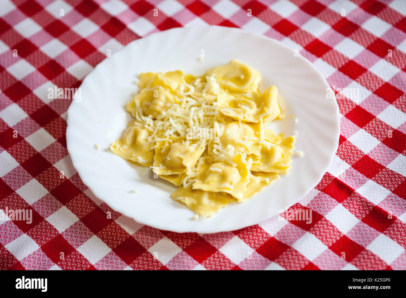 Tortellini with chese with red and white tablecloth - Stock Image