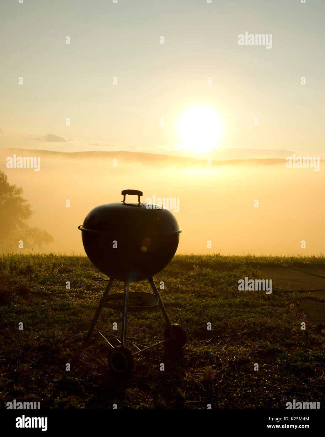 charcoal grill at sunrise - Stock Image