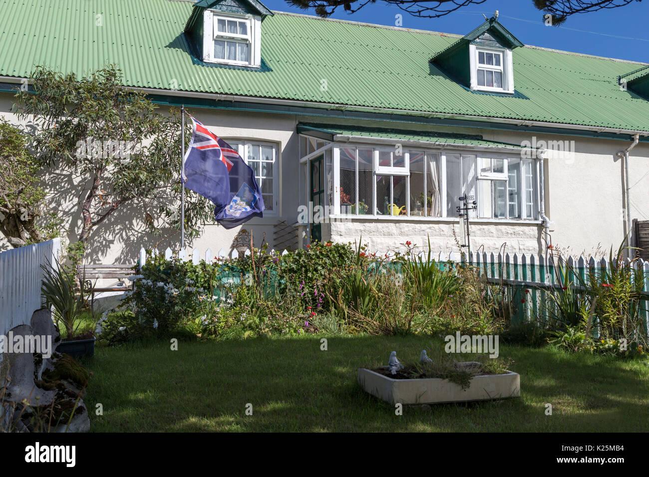 Patriotism and traditional homes  Ross Road (main street) Stanley Falkland Island (Malvinas) - Stock Image